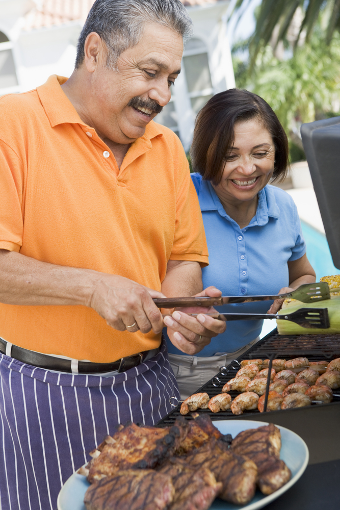 Couple Grilling Food and Smiling